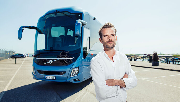 Karl Johansson, Business Development Director, Coach Europe at Volvo Buses, outside a coach.